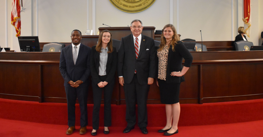 Picture of Campbell University students on the floor of the NC Senate with Senator Jim Burgin